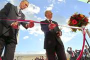 Janez Novak, left, and Sir David McMurtry cutting the ribbon at the new RLS facilities