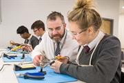 Students and a teacher from Radyr School during a design and technology lesson at the Renishaw Fabrication Development Centre