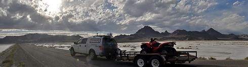 Dynascan in mountains and lake banner
