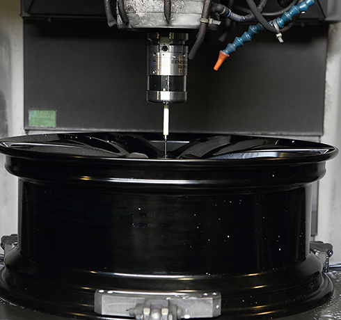 SAI - RMP60 performing in-line measurement for wheel rim production.