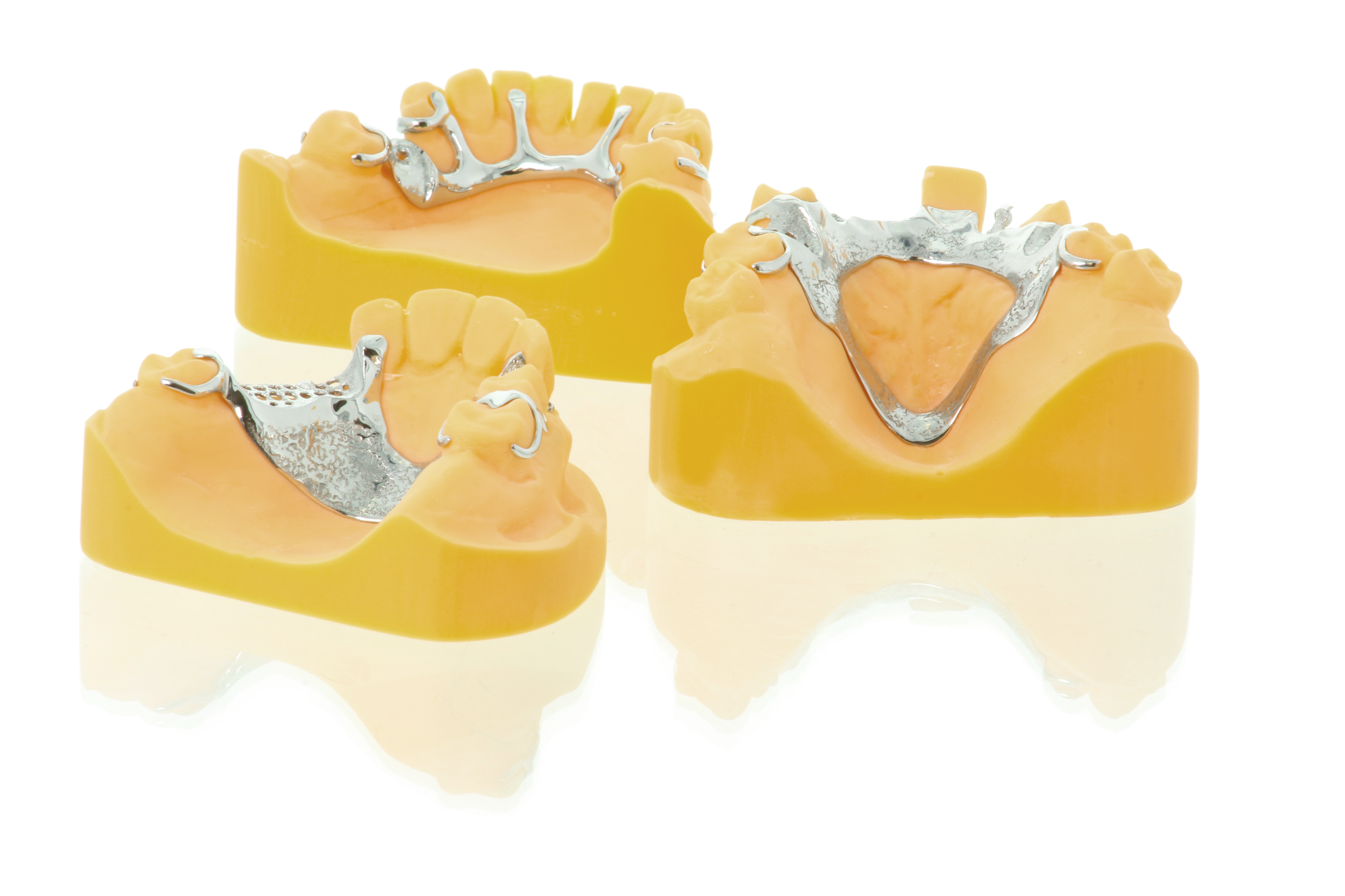 A cluster of various removable partial dentures designed by Gill Egan