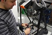 Eponsa case story - An Eponsa engineer loads a wiper mechanism part onto Equator ready for gauging