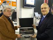 Peter Jönsson, NC Service, receives QC20-W from Ben Taylor, Assistant Chief Executive of Renishaw