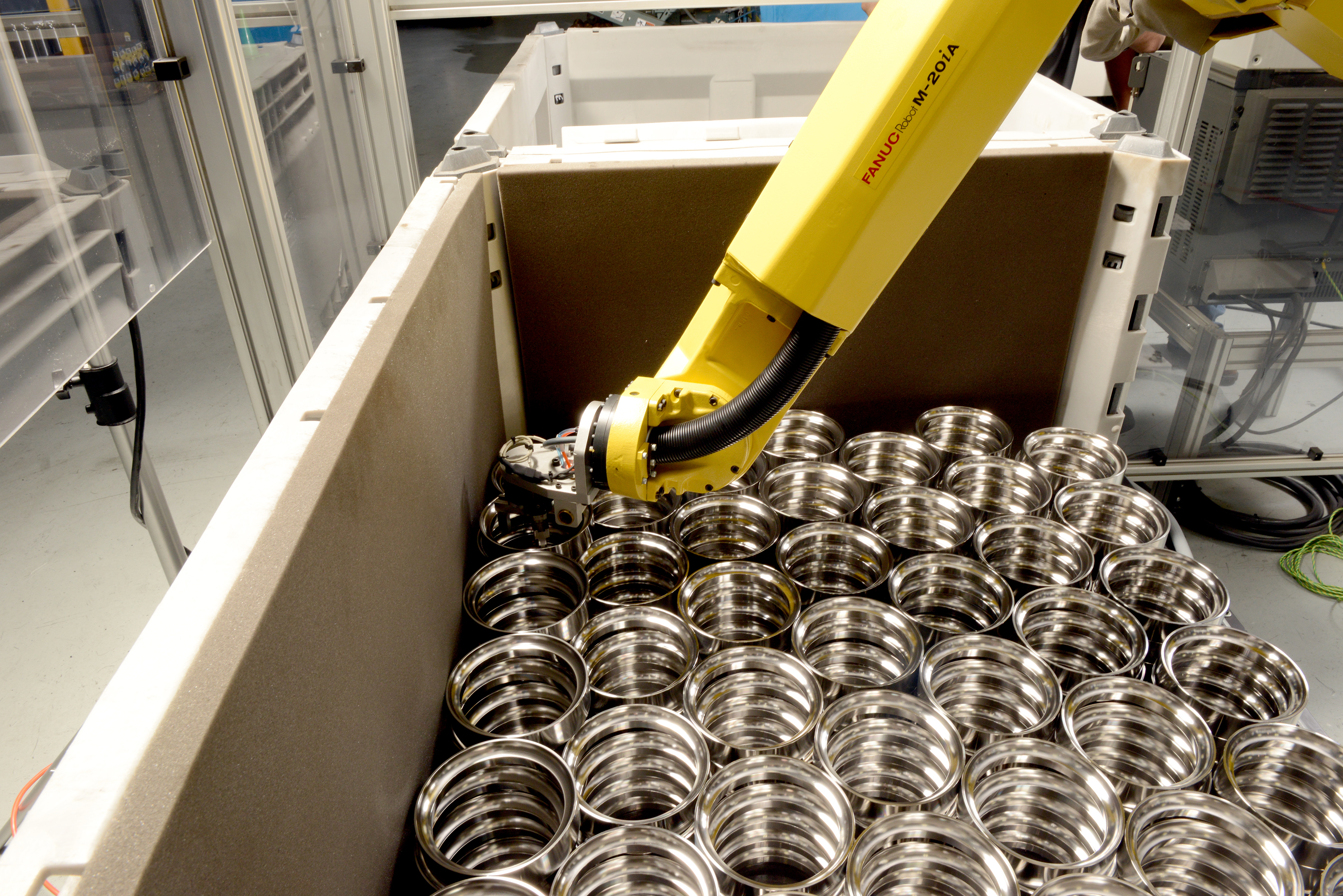 An automated FANUC robot boxes and palletises parts