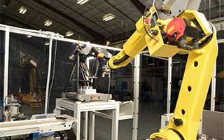 A FANUC robot loads the Equator™ in the automated cell