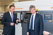 The Prime Minister and Neil Carmichael, MP for Stroud, with a Renishaw AM250 additive manufacturing (metal 3D printing) machine