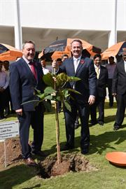 Secretary of State Liam Fox (right) plants commemorative tree with Renishaw's Rhydian Pountney