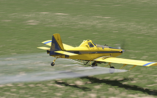 Crop spraying airplane