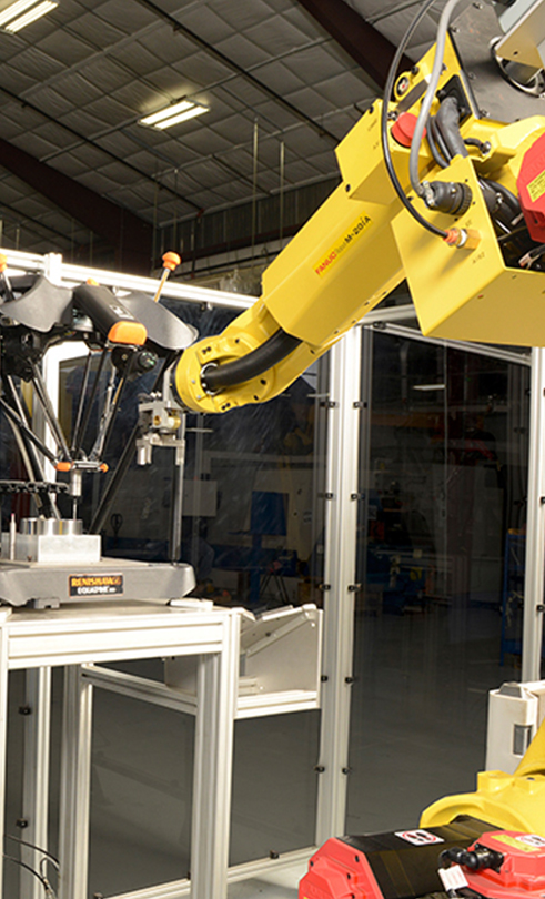 A FANUC robot loads the Equator in the automated cell