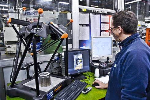 An operator measures a part on Equator at ZF Marine