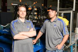 CNC programmer James Wardell and robotics technician Jeff Buck of Conroe Machine