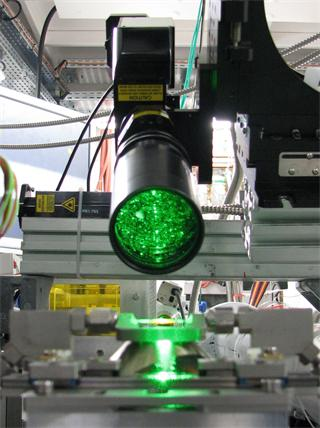 Custom Renishaw Raman probe interface deployed on the SNBL beamline